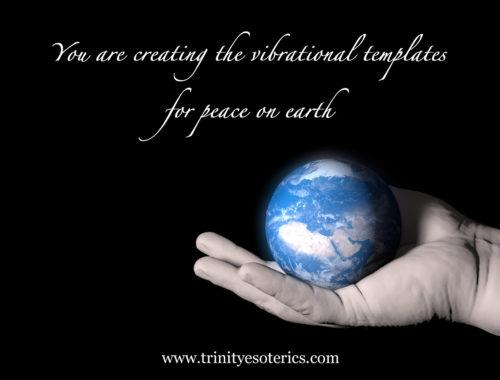 hand holding earth trinity esoterics