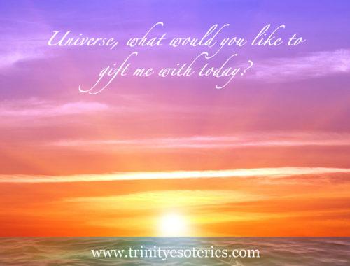 vibrant sunrise over water trinity esoterics
