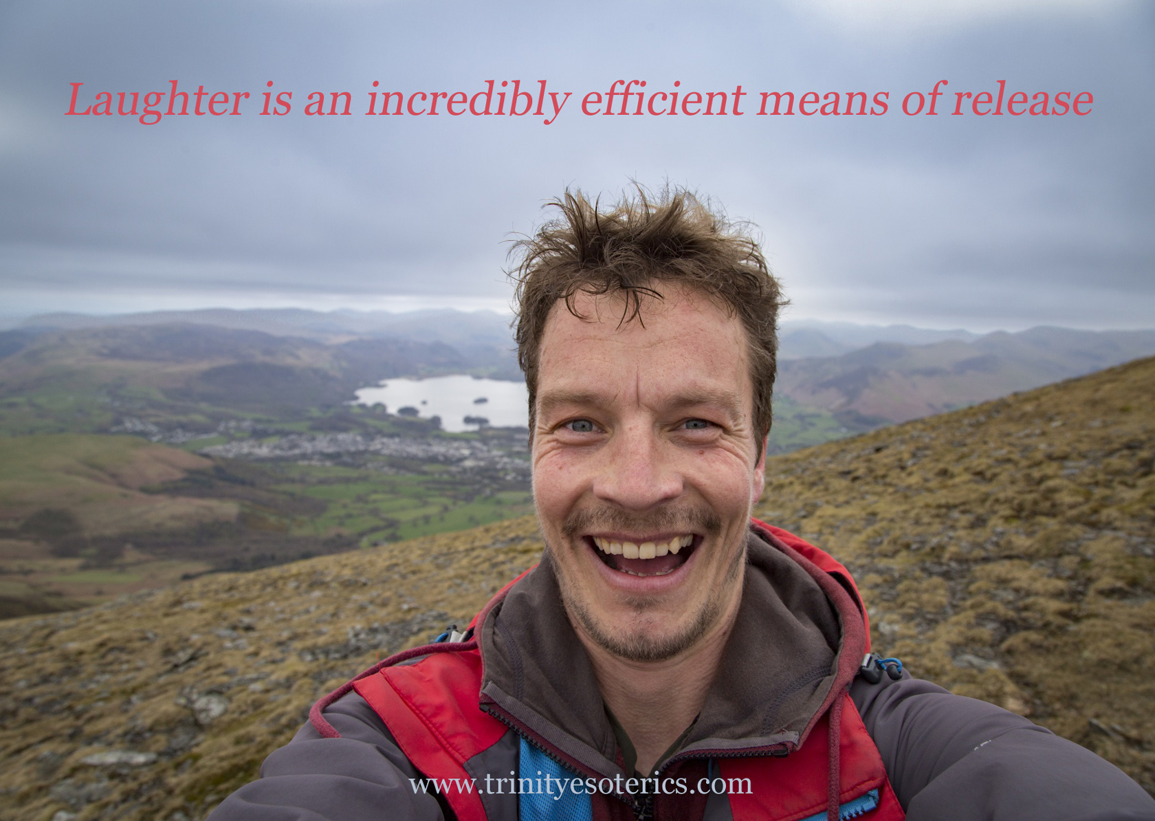 laughing man on mountain top trinity esoterics