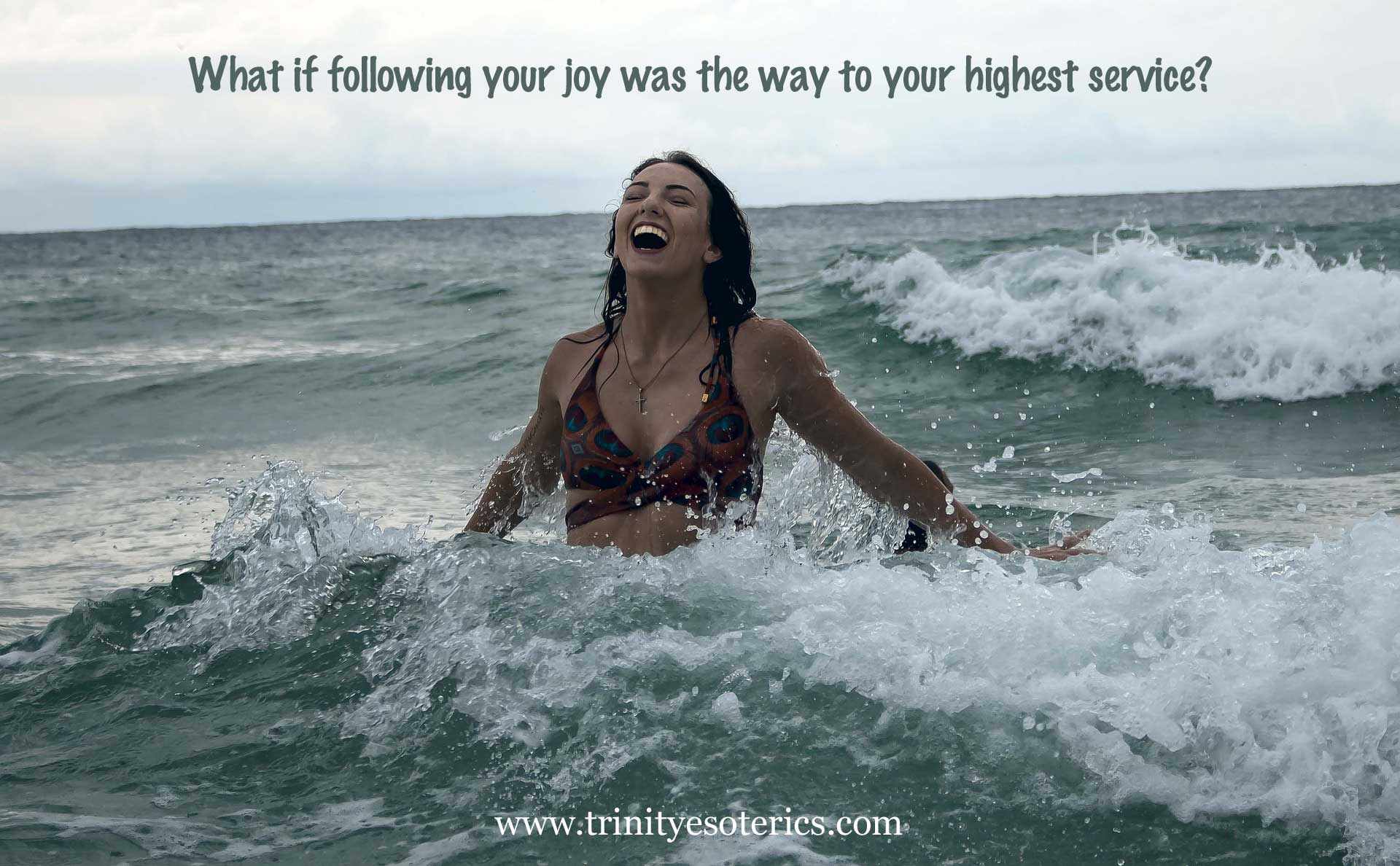 joyful woman in the surf trinity esoterics