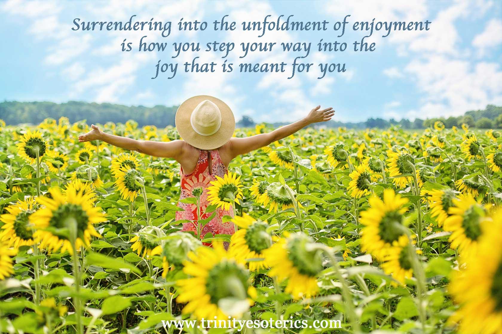 joyful woman in sunflower field trinity esoterics