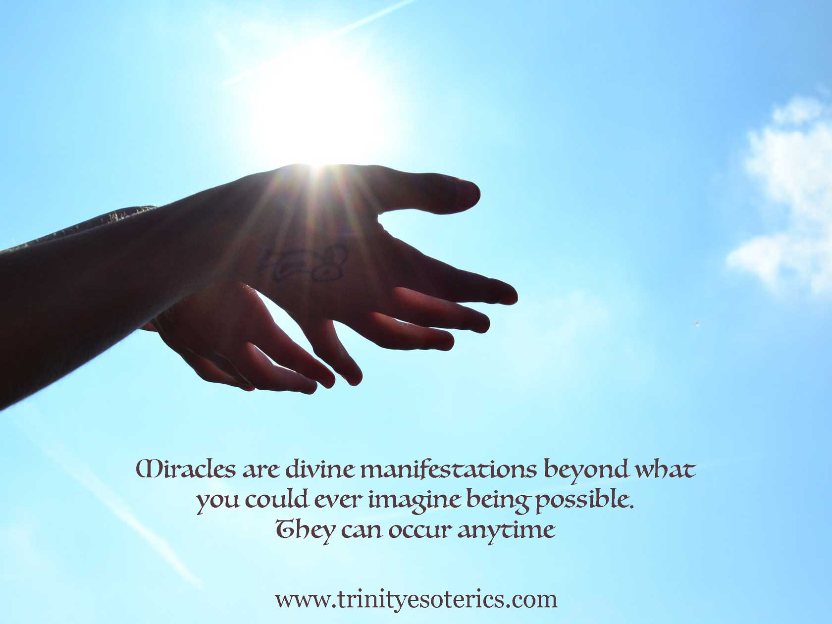 hands open to receive trinity esoterics