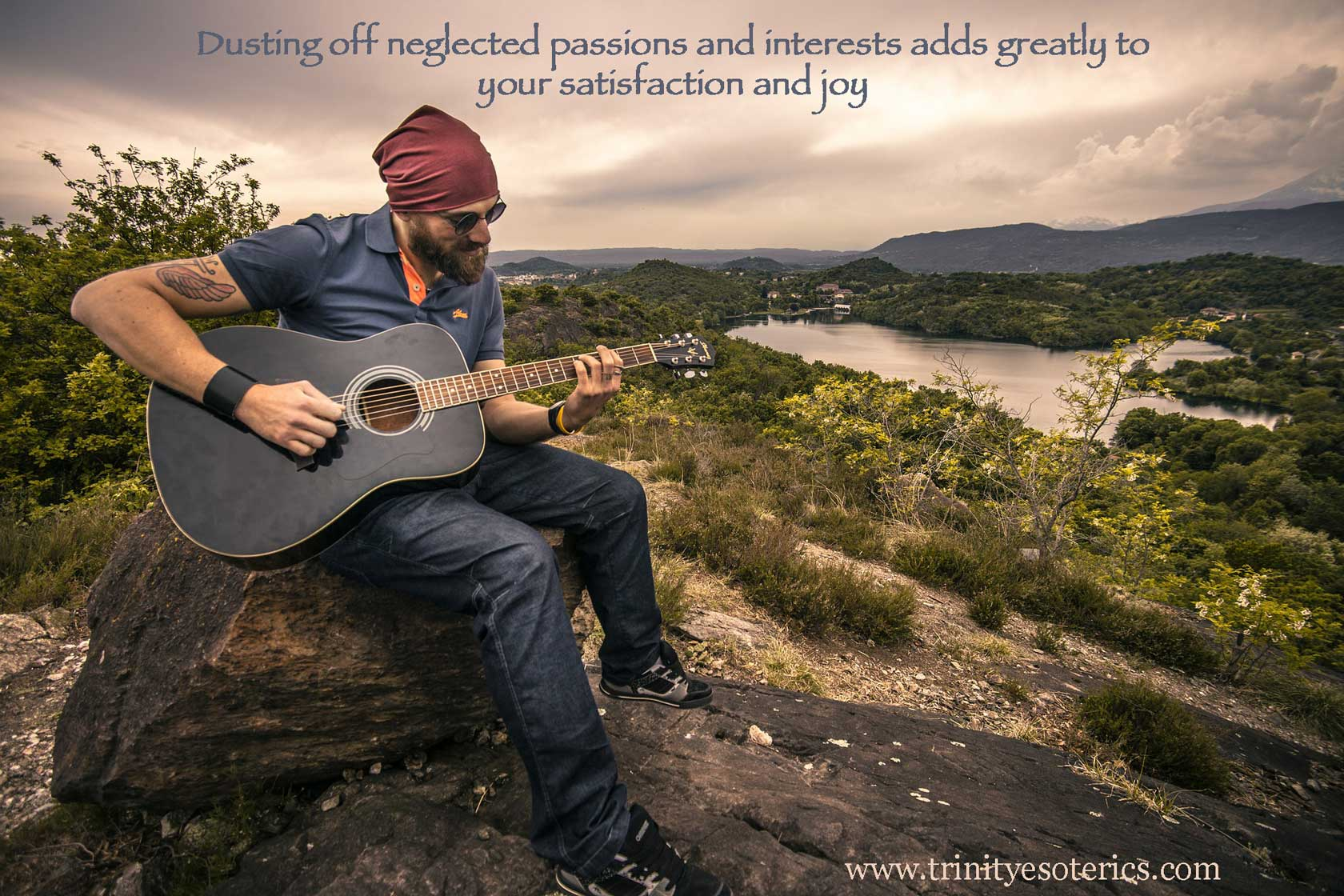 man playing guitar in nature trinity esoterics