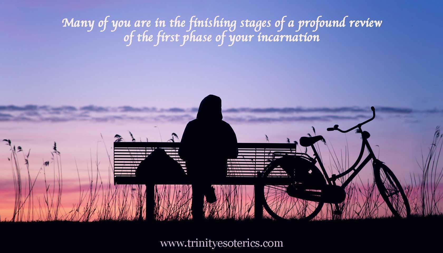 person on bench at dusk trinity esoterics