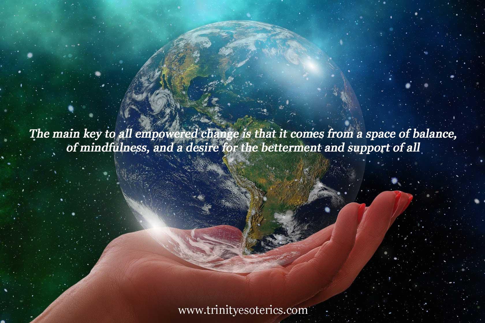 hand holding globe trinity esoterics