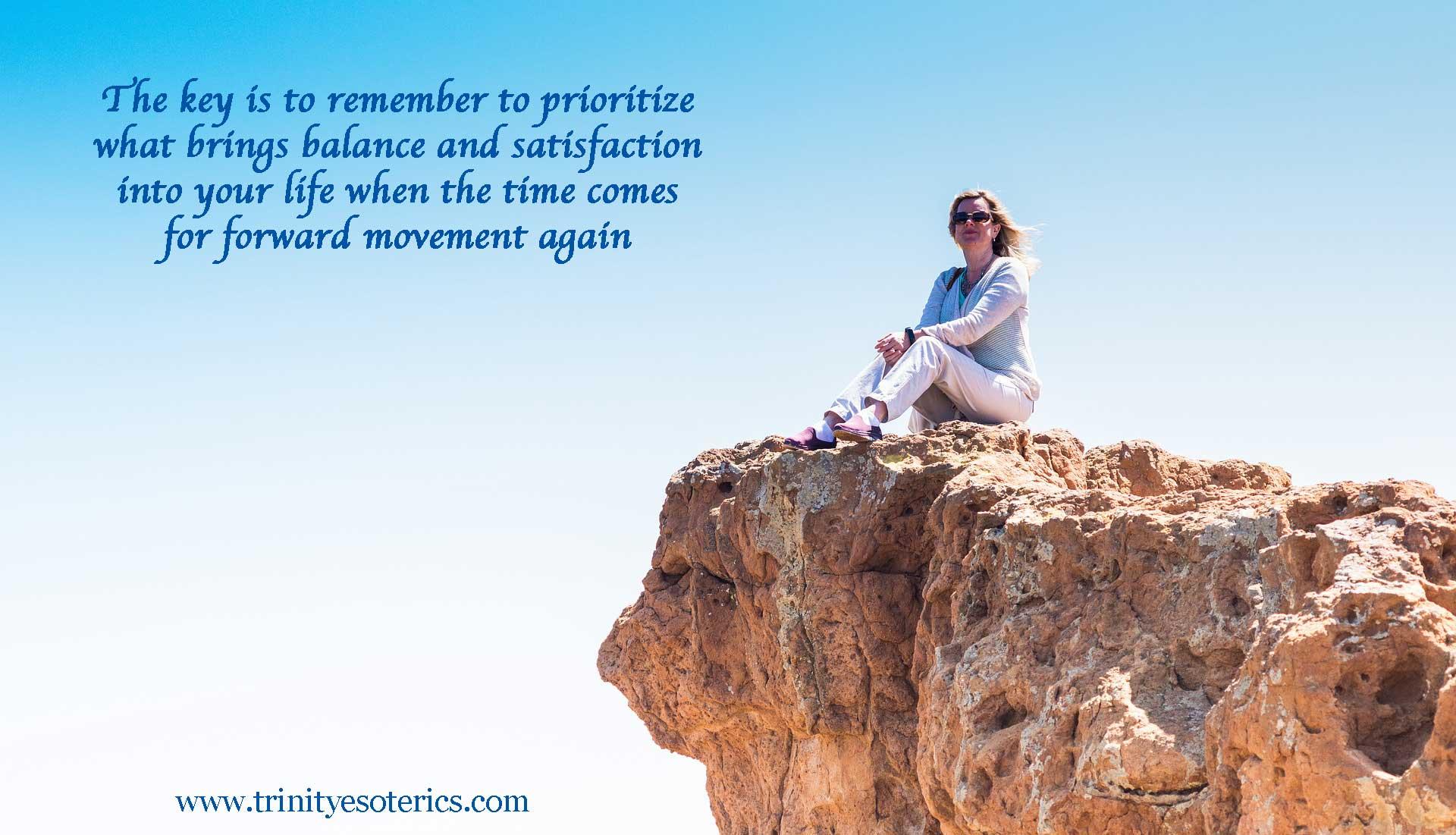 thoughtful woman on rock trinity esoterics