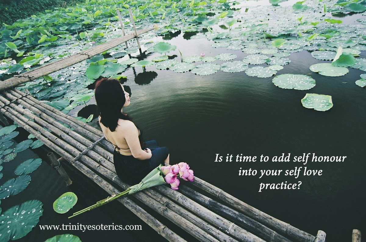 woman at lotus pond trinity esoterics