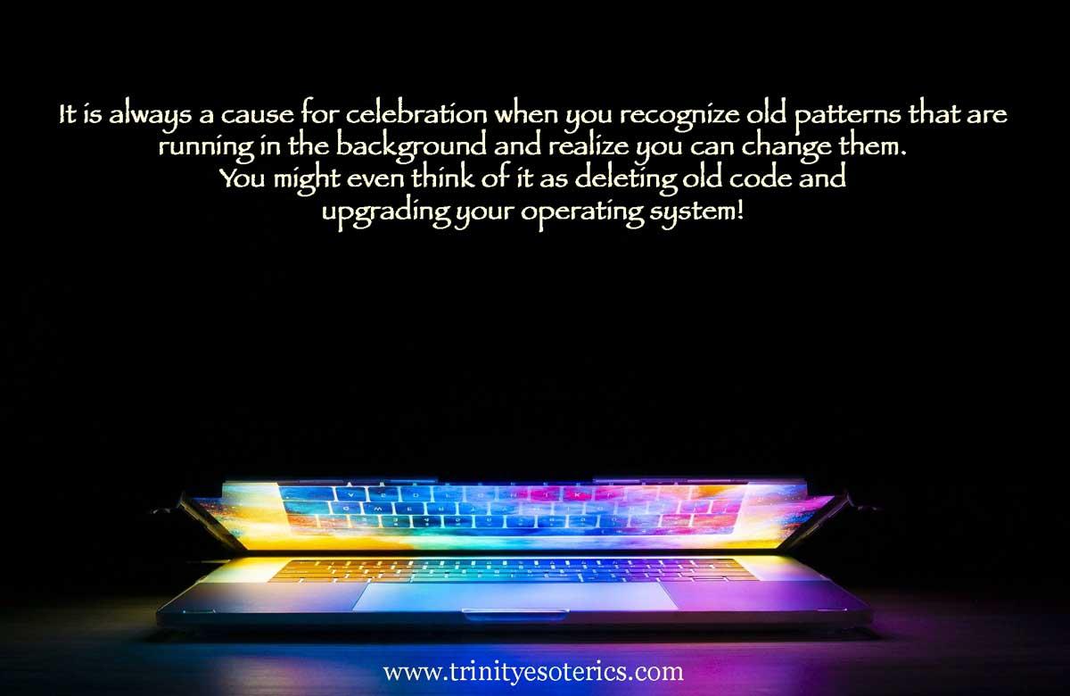 slightly open laptop full of light trinity esoterics